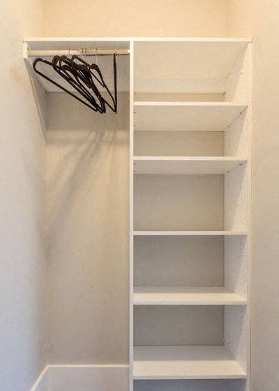 Closet with multiple shelves and storage area at Overbrook Lofts in Greenville, SC 29607