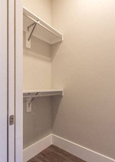 Closet area with shelves and rods at Overbrook Lofts in Greenville, SC 29607