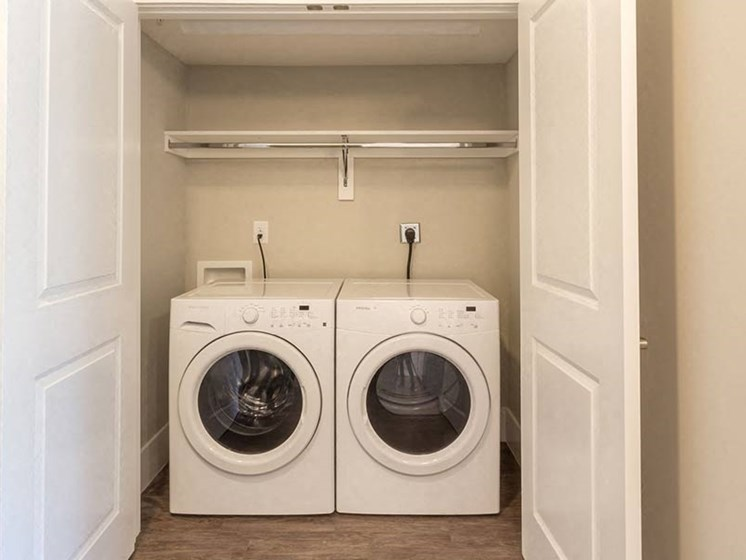 Washer dryer set in its own closet at Overbrook Lofts in Greenville, SC 29607