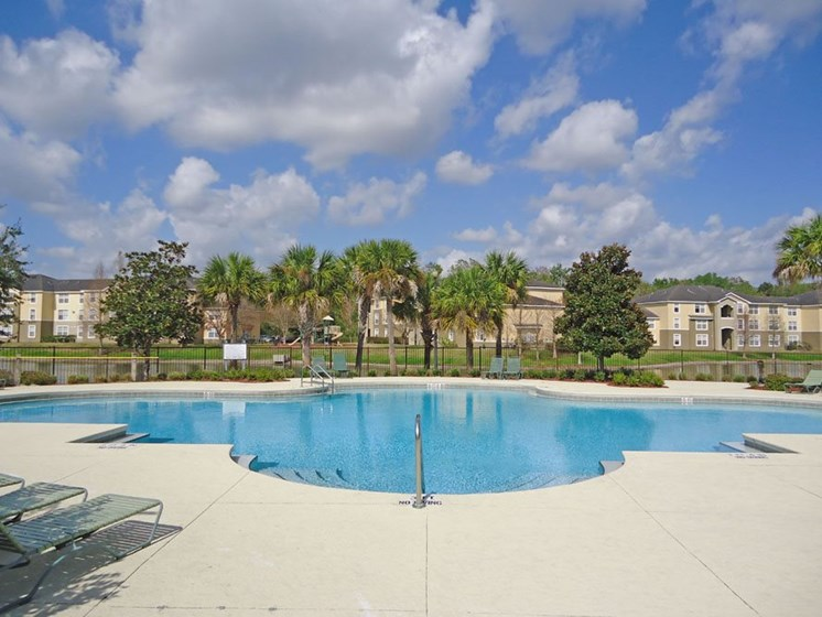 outdoor pool and pool chairs_Logan Heights Sanford, FL