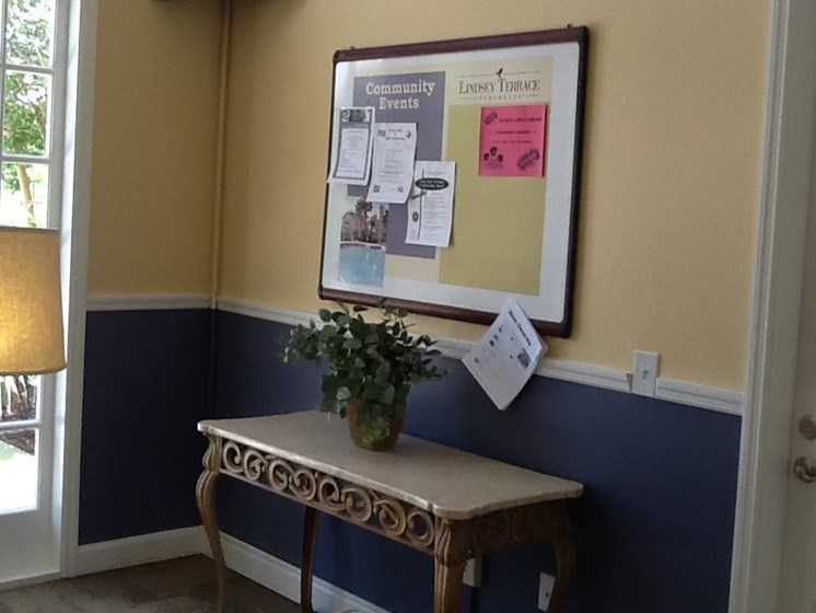 side table and bulletin board in leasing office_Logan Heights Sanford, FL