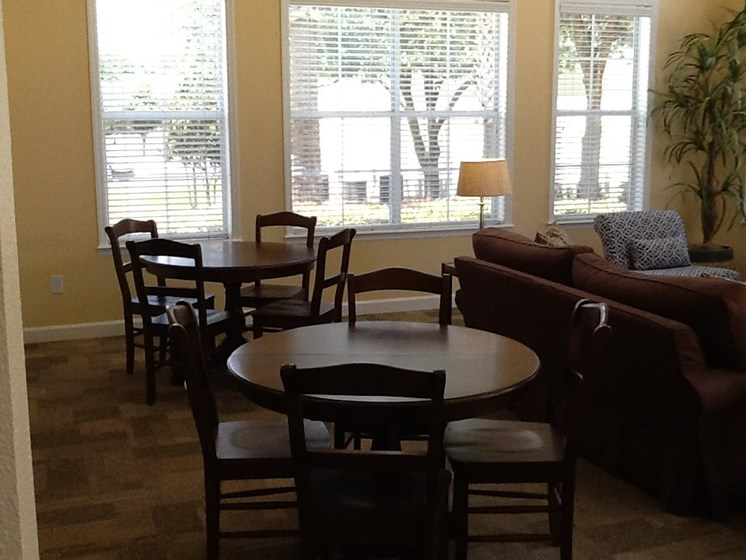 tables and chairs in common area_Logan Heights Apartments Sanford, FL