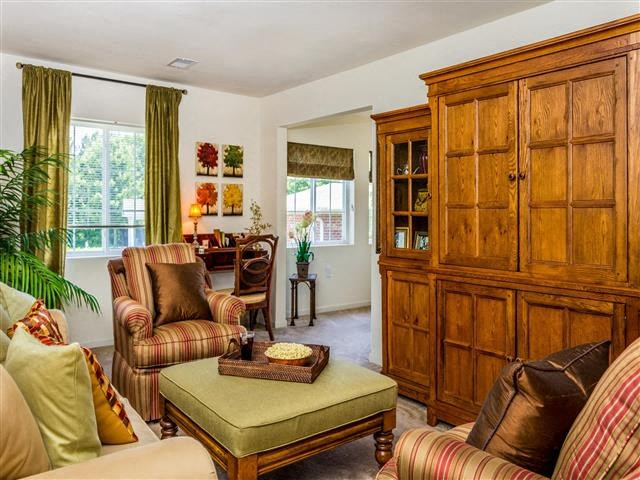 Living Rooms With Beautiful Window Coverings at Featherstone Village Apartments, North Carolina