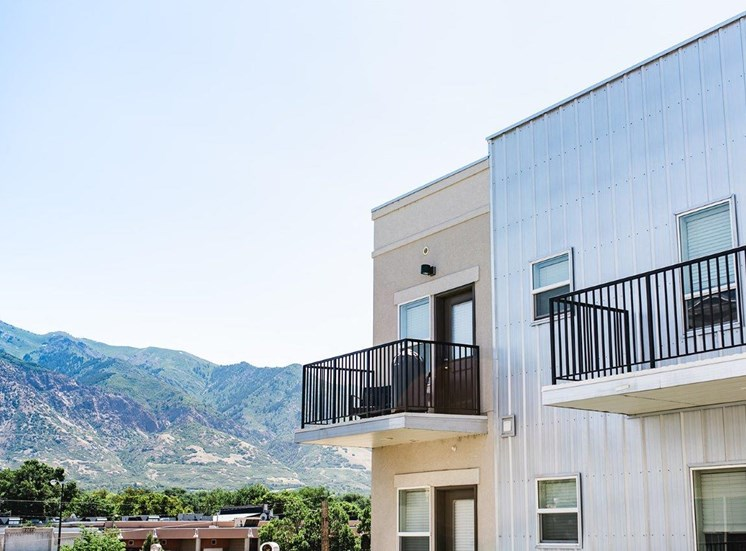 Building exterior with balconies and mountain view