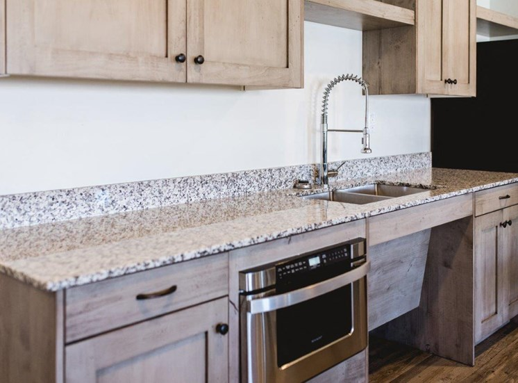 Clubhouse kitchen sink and cabinets