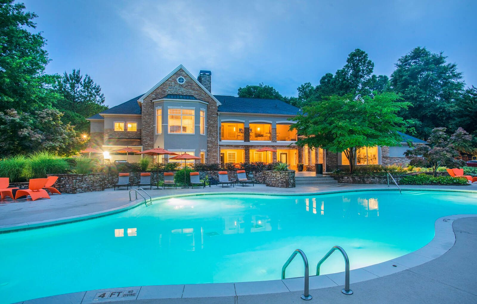Revitalizing Resort Style Swimming Pool with Relaxation Space and Seating Area at Merritt at Sugarloaf Apartment Homes, Duluth, GA 30096