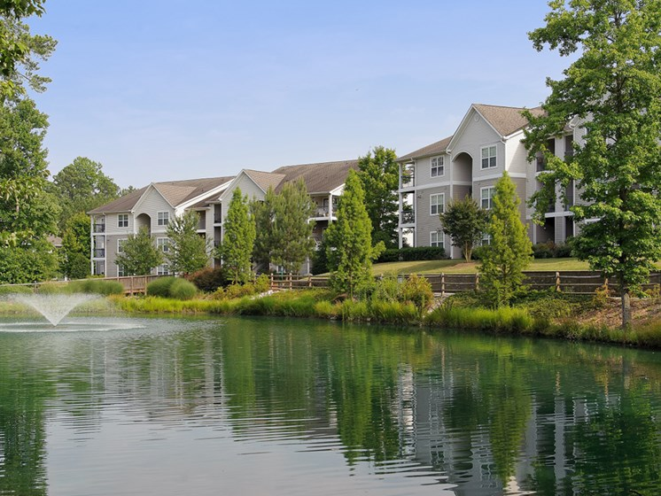 Lush landscaping, gorgeous lake with fountain and jogging trails surround you at Lake Cameron Apartment Homes, Apex, NC 27523