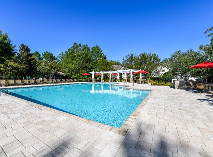 Refreshing Swimming Pool with Relaxing Poolside Lounge Chairs at Lake Cameron Apartment Homes, Apex, NC 27523
