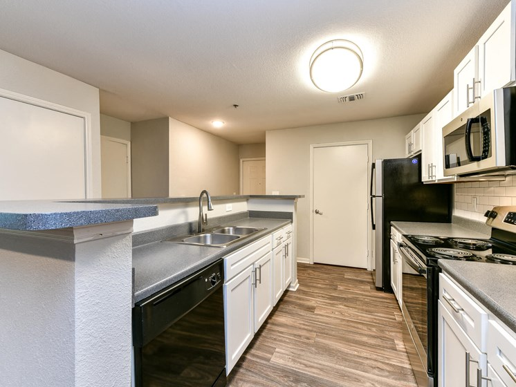 Fully Equipped Gourmet Kitchen and Pantry, with Breakfast Bar and Custom Backsplash at Lake Cameron Apartment Homes, Apex, NC 27523
