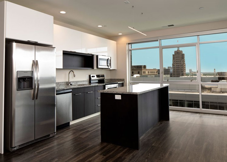 Apartment unit kitchen with views of Downtown Fort Wayne at Skyline Tower Apartments, Fort Wayne, 46802