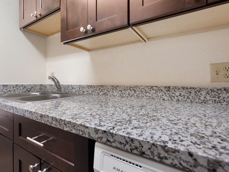Kitchen at Woodridge Apartments in Tucson, AZ