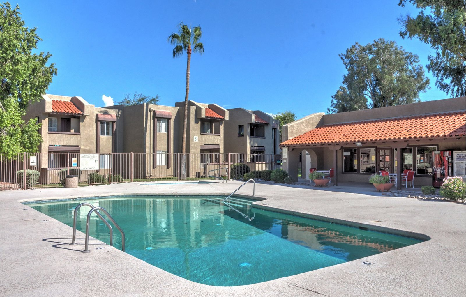 Pool and patio at Woodridge Apartments in Tucson, AZ