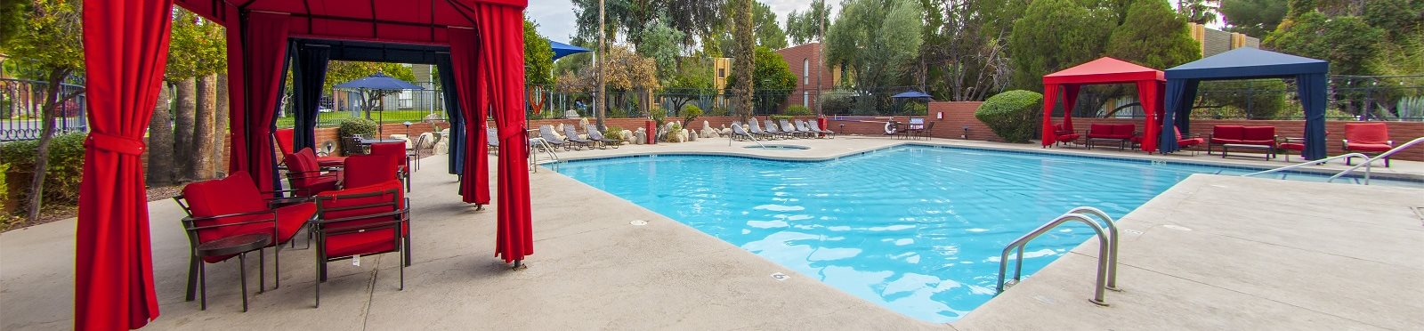 Cabana, pool, and pool patio at Mission Palm Apartments in Tucson, AZ
