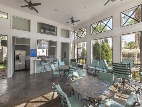 Heritage on Millenia Apartments in Orlando, FL Clubhouse Sun-room with Kitchen and Bar