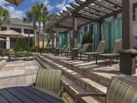 Heritage on Millenia Apartments in Orlando, FL Poolside Lounge Seating
