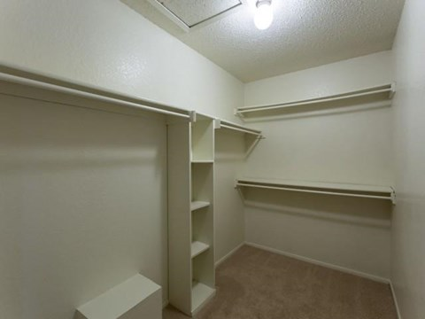 Spacious Walk-in Closets with Custom Shelving