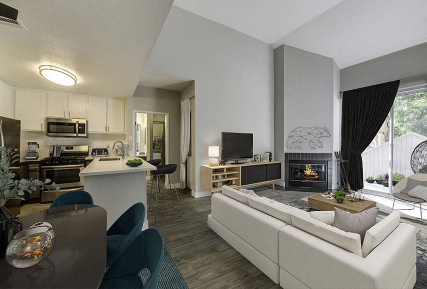Full view of living with fireplace and kitchen l The Retreat