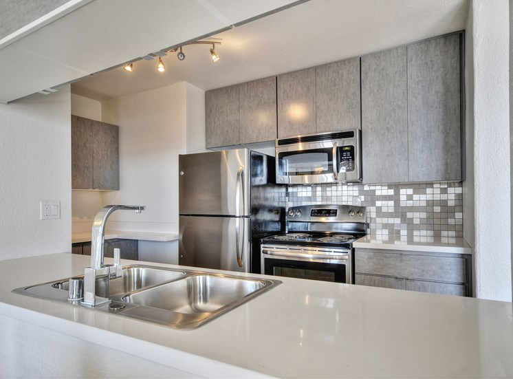 Kitchen with sink and appliances Oakland CA Apts for rent Merritt on 3rd
