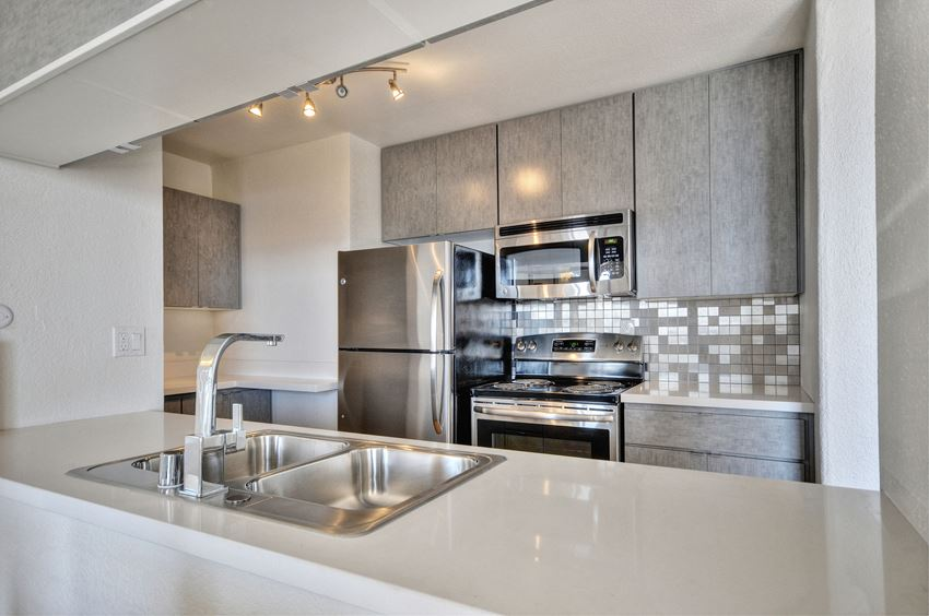 Apartments Downtown Oakland, CA- Merritt on 3rd Apartments Kitchen with Stainless Steel Appliances and Cabinetry