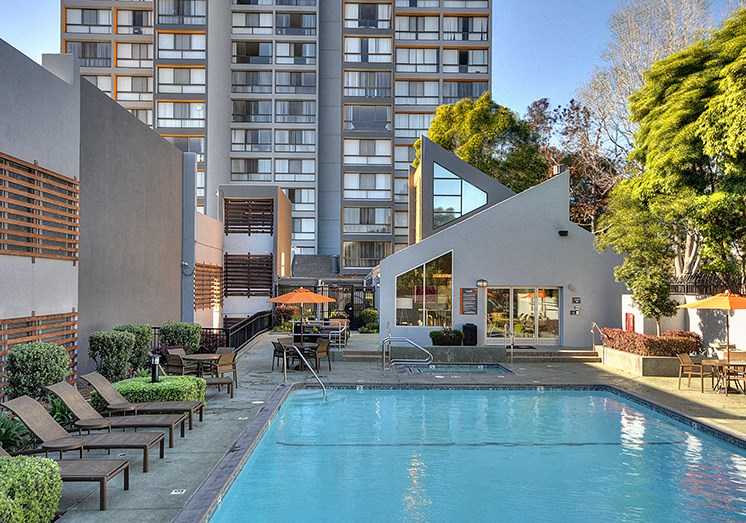 Pool with Lounge Chairs and Apt buildingMerritt on 3rd Apt homes for rent in Oakland, CA