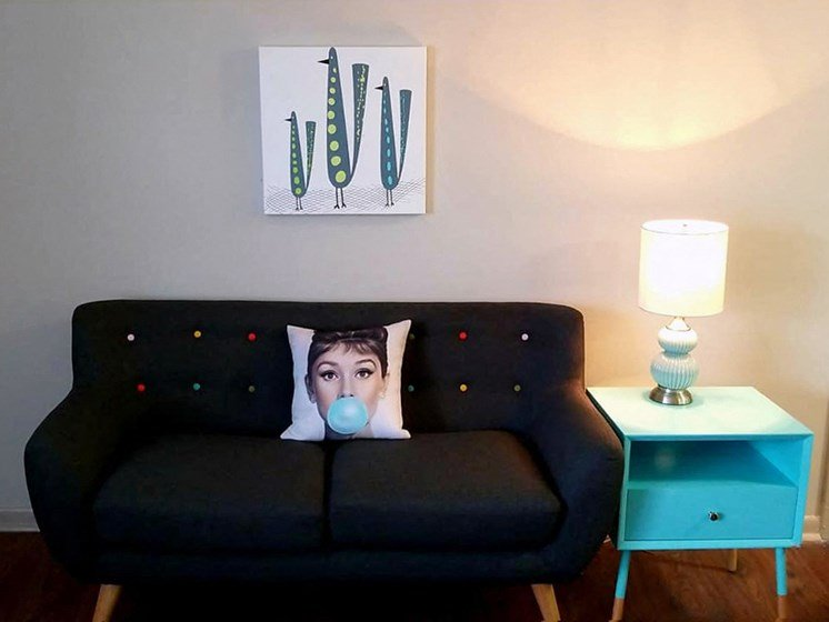 The Murals on Niazuma Apartments in Birmingham, AL 35205 sofa in living room in office