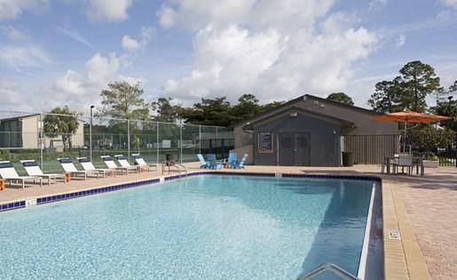 Pool deck at Hidden Harbor Apartments in Royal Palm Beach, FL