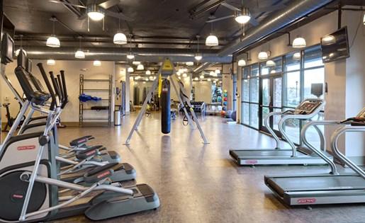 Fitness center at Lofts at Weston Lakeside Apartments in Cary, NC