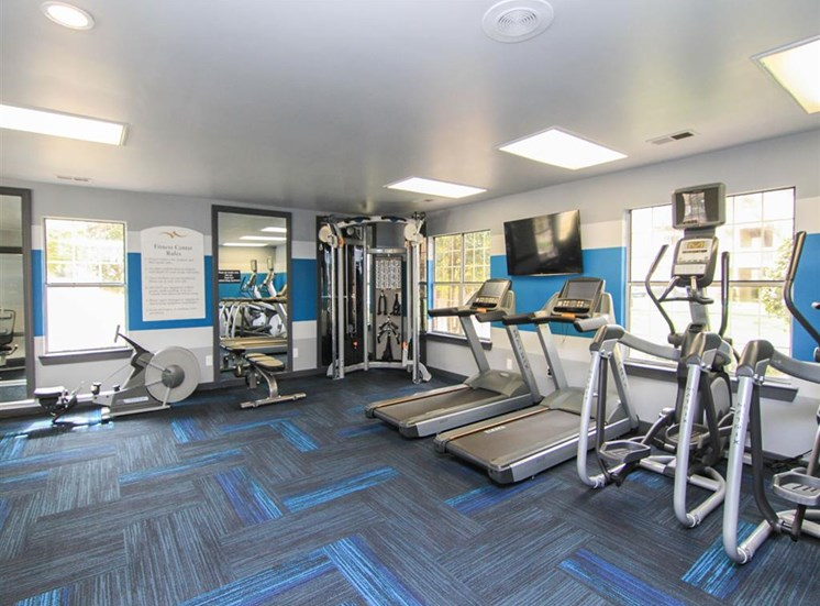 Updated equipment added to the fitness center at Reafield Village Apartments in Charlotte, NC