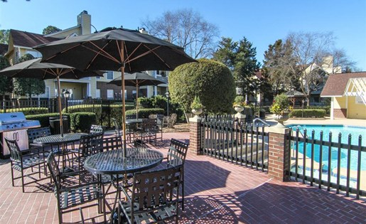 Poolside picnic areas at Reafield Village Apartments in Charlotte, NC