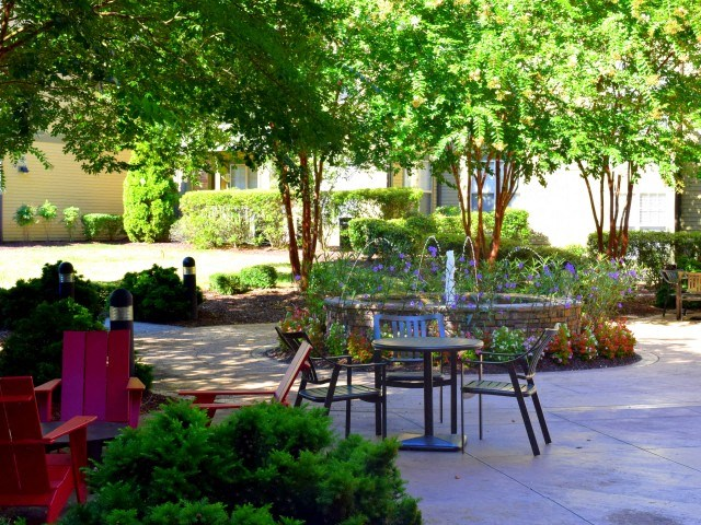 Lush garden and greens at Southpoint Village Apartments in Durham, NC