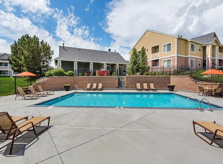 Relaxing Pool Area With Sundeck at Village at Westmeadow Apartments, Colorado Springs, 80906