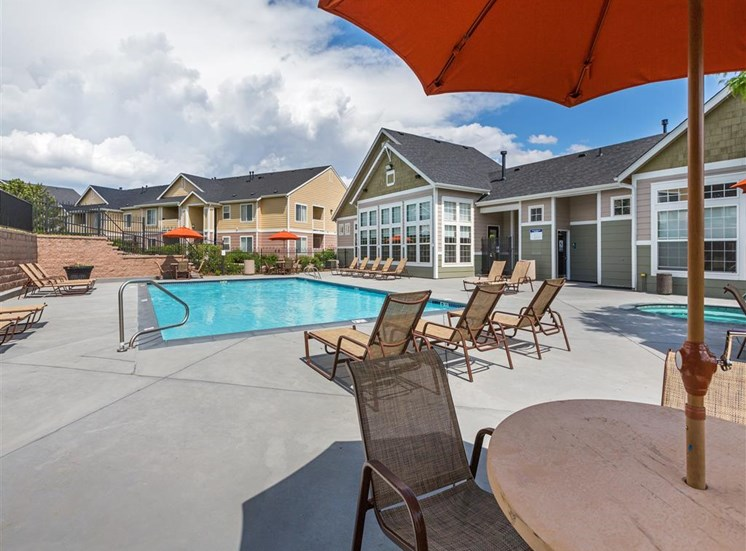 Poolside Dining Tables at Village at Westmeadow Apartments, Colorado Springs, CO