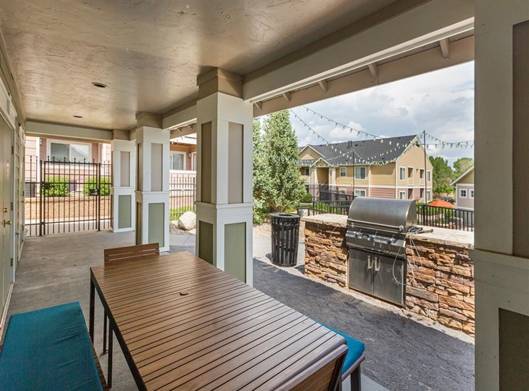 Outdoor Grill With Intimate Seating Area at Village at Westmeadow Apartments, Colorado