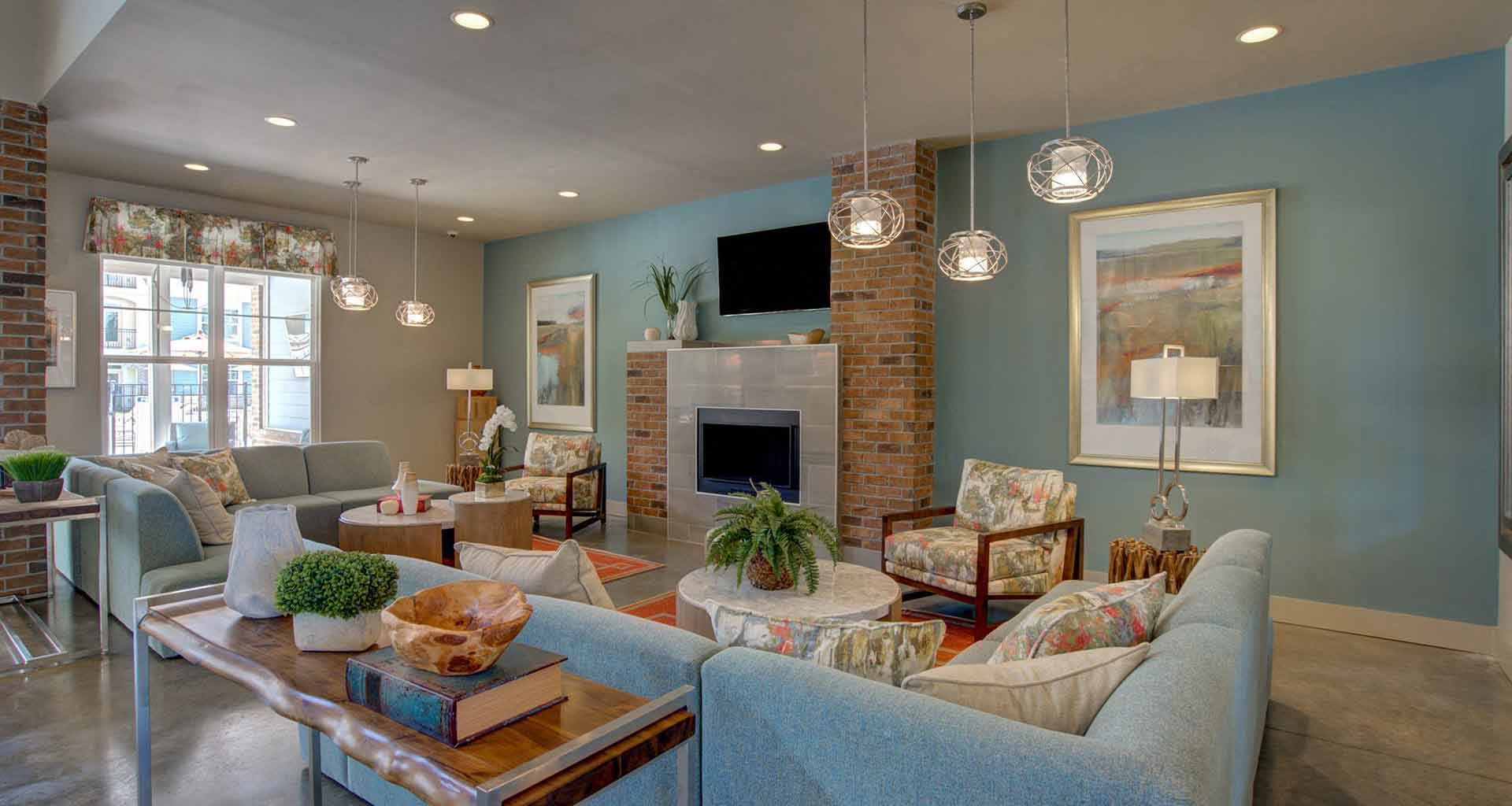 Living room remodel with standard fireplace at Beckstone Apartments, Summerville, South Carolina