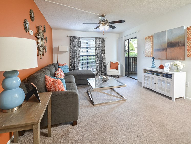 Carpeted Living Room and Ceiling Fan