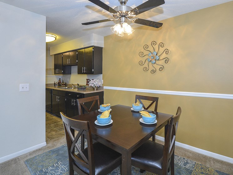 Dining Room Area with Ceiling Fan and Light