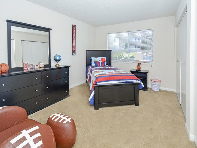 Large Bedroom with Double Windows and Plush Carpet