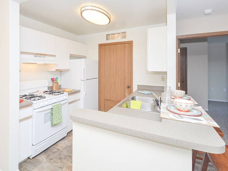 Kitchen with White Appliances and Breakfast Bar