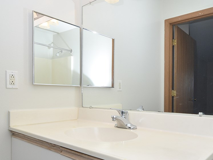 Bathroom with Vanity and Built-In Overhead Lighting
