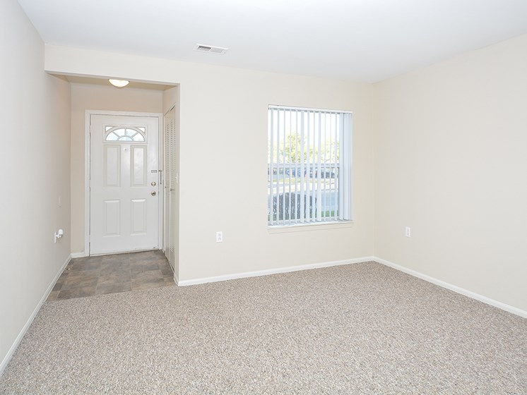 Apartment Home Entry Way with Closet and Tile Style Flooring