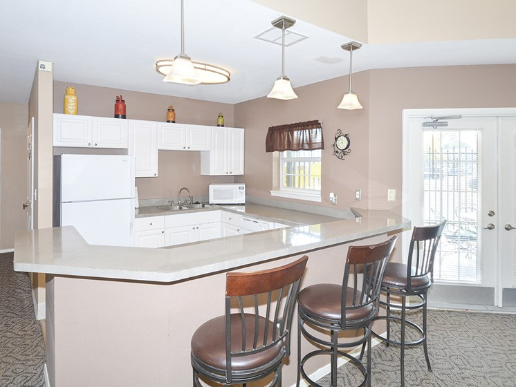 Clubhouse Kitchen with Expansive Breakfast Bar and Barstool Seating