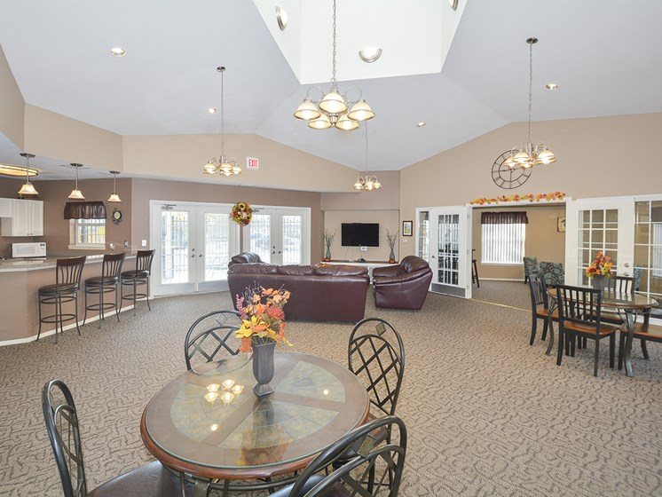 Spacious Clubhouse Lounge, Kitchen and Tables with Vaulted Ceilings