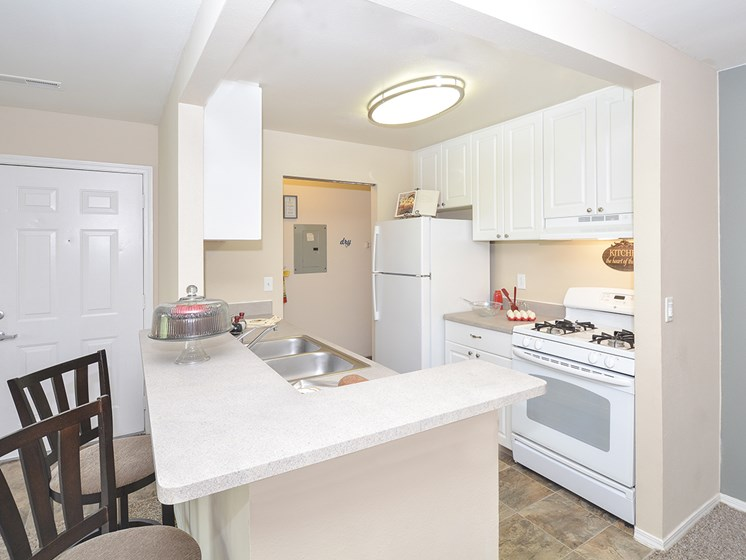 Kitchen with Breakfast Bar and Barstool Seating