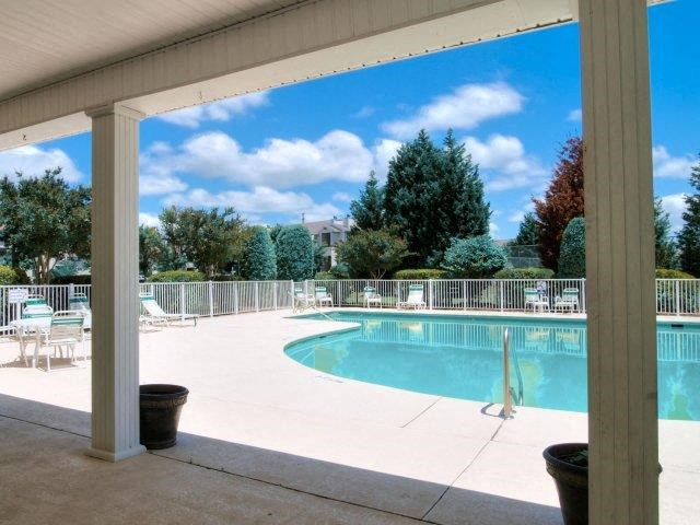 Shaded Lounge Area by Pool at Treybrooke Village Apartments, North Carolina, 27406
