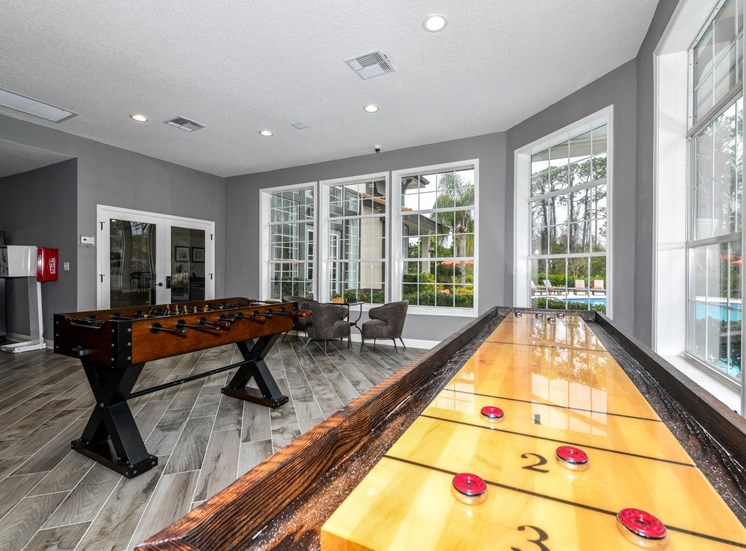 Lounge and Game Room with Mrs. Pac Man and Sand Shuffle Board at Paradise Island Apartments, Jacksonville, FL 32256