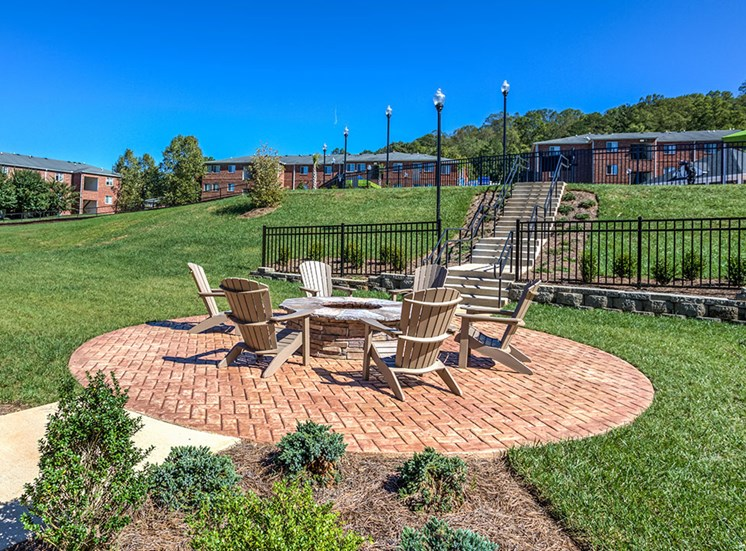 outdoor seating area next to fire pit for apartments in asheville