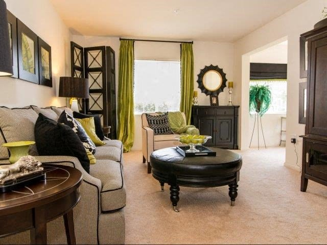 Living Room Interior With Lush Wall-to-Wall Carpeting at Cedarcrest Village Apartments, Lexington, South Carolina