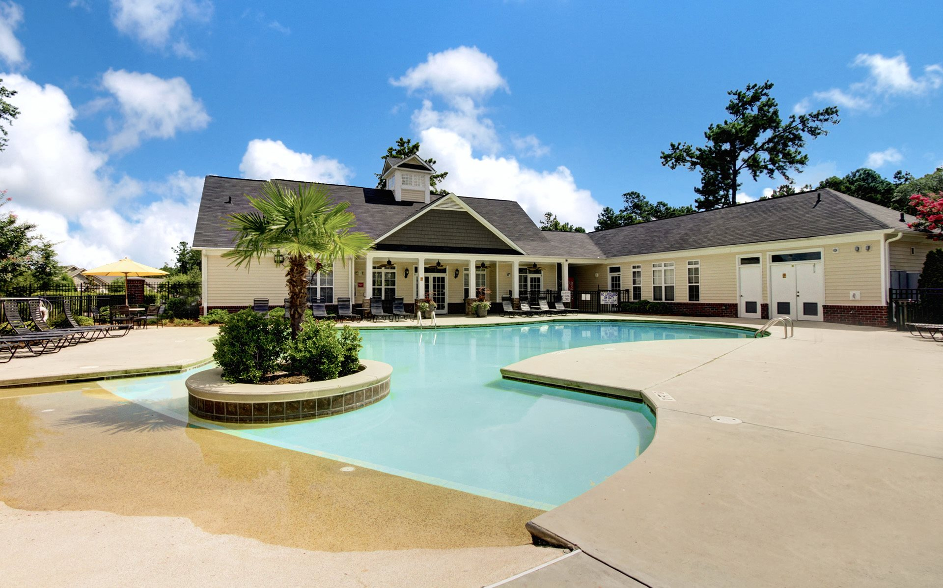 Pool Side Relaxing Area Cobblestone Village Apartments