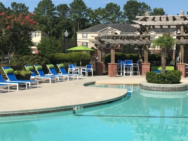 Pool Side Relaxing Area at Cobblestone Village Apartments, Summerville