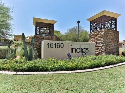Indigo apartments monument sign with lawn